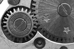Black white Metallic Background with metal cogwheels a clockwork Royalty Free Stock Images