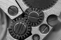 Black white Metallic Background with metal cogwheels a clockwork Royalty Free Stock Photo