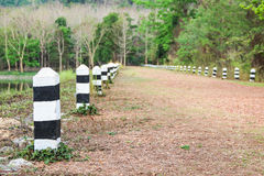 Black and white milestones on a country road Royalty Free Stock Images