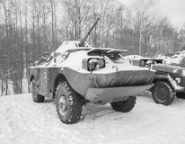 Black and white military vehicle of the Russian army BRDM winter Stock Photo