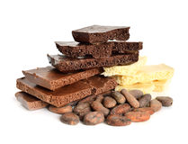 Black, white and milk air chocolate with Cocoa beans before roas Stock Photos