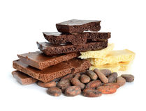 Black, white, milk air chocolate with Cocoa beans before roast Stock Photos