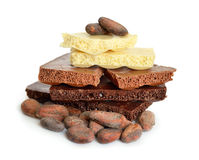 Black, white, milk air chocolate with Cocoa beans before roast Royalty Free Stock Photos