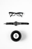 Black and white minimalistic composition: glasses, watches and magic ball 8. Royalty Free Stock Photography