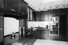 Black and white modern kitchen with stylish furniture Stock Images