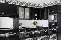Black and white modern kitchen with stylish furniture royalty free stock images