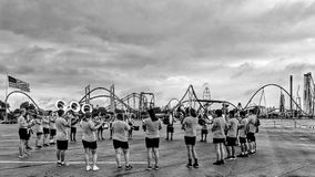 Marching Band practices in parking lot Cedar Point Sandusky Ohio. Black and White Monochromatic photo musicians warming up under dramatic skies Stock Images