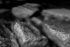 Monochrome, abstract, dark gloomy background, stones immersed in sea water with visible texture . Black and white, monochrome, abstract, background royalty free stock photography