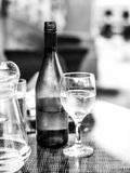 Black and White Monochrome Image of a Glass of White wine Next T Royalty Free Stock Photo