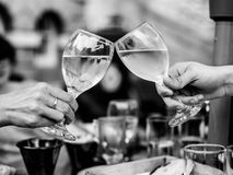 Black and White Monochrome Image of Celebrating Success With Two Royalty Free Stock Photos