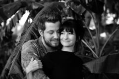 Portrait of Two Cute Modern Caucasian Beautiful Young Adult Guy Boyfriend Lady Girlfriend Couple Hugging and Kissing in Love in Na. Black and White Monochrome royalty free stock image