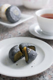 Black and white moon cakes serve with chinese tea Royalty Free Stock Photography