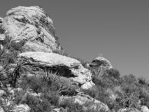 Black and white moon over rocks royalty free stock photo