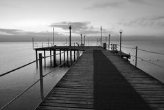 Black and white morning pier. Black and white image of morning pier. Turkey, Analya, Kemer Stock Photos
