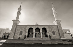 Black and white mosque with two minarets. A black and white mosque with two minarets Royalty Free Stock Photography