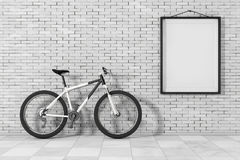 Black and White Mountain Bike in front of Brick Wall with Blank Royalty Free Stock Photos