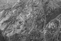 Black and white mountain granite vertical wall. Particular of a mountain shore from Val Masino in the italian alps smooth sunlight royalty free stock photo