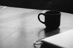 Black and White Mug on Table Stock Photo
