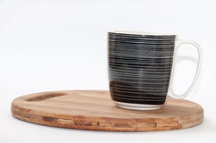 Black and white mug on the wooden board Royalty Free Stock Images