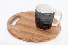 Black and white mug on the wooden board Royalty Free Stock Image