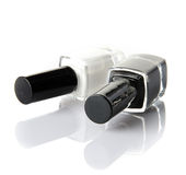 Black and white nail varnish Stock Images
