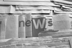 Black and white news on newspaper stock photos