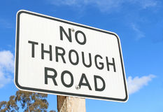 A black and white 'No Through Road' sign against a blue sky Stock Photography