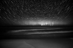 Black and White Northern Lights Star Trail Lake Superior. 20 minute live composition star trail in Marquette Michigan on lake superior shore Stock Photography