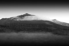 Black and white Norway mountain peak in clouds background. Hd Stock Photo