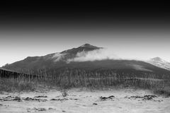 Black and white Norway mountain peak in clouds background. Hd Stock Photography