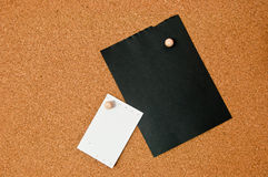 Black and white note paper on cork board Stock Photo