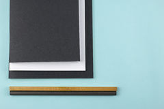 Black and white notebooks and pencils Royalty Free Stock Photo