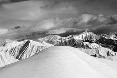 Black and white  off-piste snowy slope and cloudy mountains Stock Images