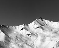 Black and white off-piste snowy slope in winter mountain Stock Photo