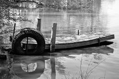 Black and white, Old, abandoned boat dock on a small lake Royalty Free Stock Images