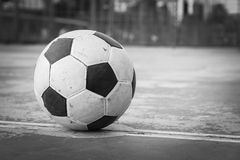 Black and white old ball at kick off point. Black and white old football at kick off point stock photography