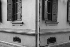 Black and White old building with window in Bangkok. Black and White old building with different type of windows which is all symmetrical in Bangkok Stock Photo