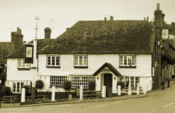 Black and white old english kent country pub. Black and white photo of an old 17th century english country pub in kent, showing nice detail of georgian pane Stock Photo