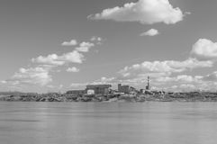 Black and white, old factory on the shore of the lake. Royalty Free Stock Photos