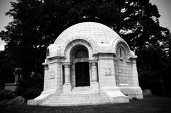 Black and White Old Mausoleum. Old Mausoleum on Sleepy Hollow Cemetary Grounds in Black and White Royalty Free Stock Image