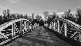 Steel bridge crossing in black and white. Abstract monochrome shadows and shilouette photography
