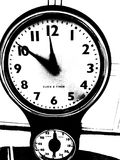 Ticking clock. Black and white old styled clock on wall, ticking time Royalty Free Stock Photography
