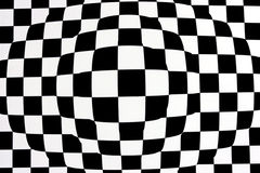 Black white op-art. A background of distorted black and white squares Stock Photography