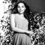 Black-white outdoor portrait of beautiful emotional young brunette woman in stylish dress Royalty Free Stock Photos