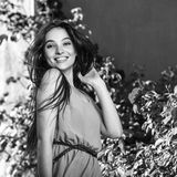 Black-white outdoor portrait of beautiful emotional young brunette woman in stylish dress Stock Photos