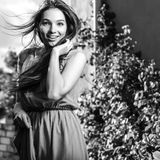 Black-white outdoor portrait of beautiful emotional young brunette woman in stylish dress Royalty Free Stock Images