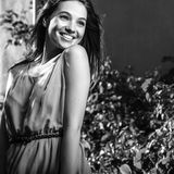Black-white outdoor portrait of beautiful emotional young brunette woman in stylish dress Royalty Free Stock Photography