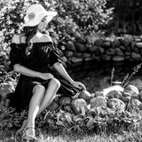 Black-white outdoor portrait of beautiful young woman in classic hat Stock Images