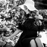 Black-white outdoor portrait of beautiful young woman in classic hat Royalty Free Stock Photo