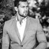 Black-white outdoor portrait of elegant handsome man in classical grey suit poses outdoor.  royalty free stock photo